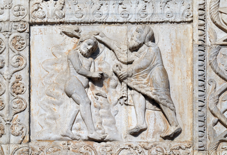 Baptism of the Christ, medieval relief on the facade of Basilica of San Zeno in Verona, Italy