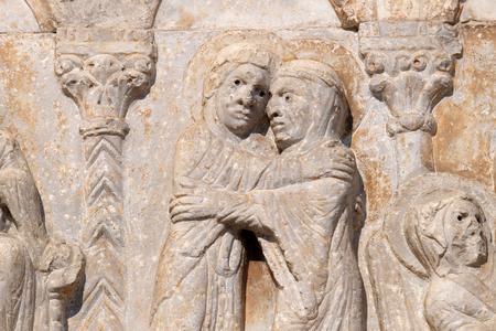 Visitation of the Virgin Mary, medieval relief on the facade of Basilica of San Zeno in Verona, Italy Stock Photo