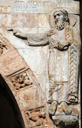 Saint John the Baptist, medieval relief on the facade of Basilica of San Zeno in Verona, Italy Stock Photo