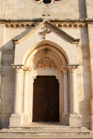 Entrance portal of the Church of Blessed Virgin of Purification in Smokvica, Korcula island, Croatia
