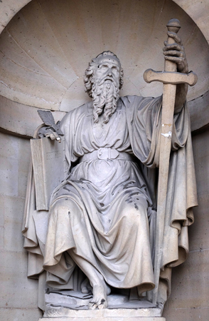 Saint Paul the Apostle, statue on the portal of the Saint Sulpice Church, Paris, France Editorial