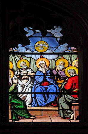 Descent of the Holy Spirit, stained glass window in Saint Severin church in Paris, France Editorial