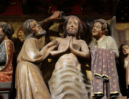 Intricately carved and painted frieze inside Notre Dame Cathedral depicting Baptism Of The Lord, UNESCO World Heritage Site in Paris, France