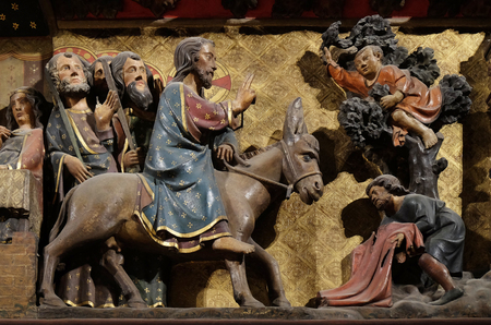 Intricately carved and painted frieze inside Notre Dame Cathedral depicting Jesus triumphal entry into Jerusalem, Palm Sunday, UNESCO World Heritage Site in Paris, France Editorial