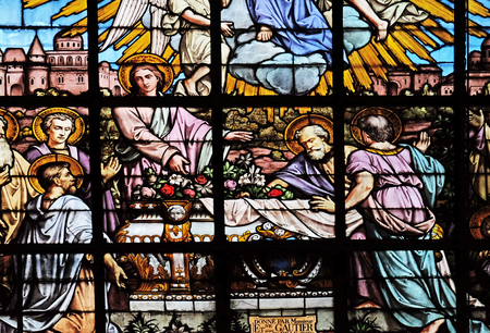 Apostles before the empty tomb of the Virgin Mary by Edouard Amedee Didron, stained glass window in Saint Thomas Aquinas in Paris, France Editorial