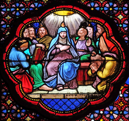 Descent of Holy Spirit, Pentecost , stained glass window in the Basilica of Saint Clotilde in Paris, France Editorial