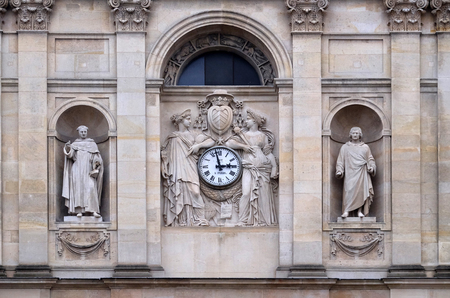 St. Thomas Aquinas, Pierre Lombard, muses support the clock, topped by the coat of arms of Cardinal Richelieu, facade of the St Ursule chapel of the Sorbonne in Paris