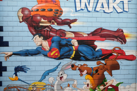 Superman, graffiti wall mural comic book, flea market, St. Ouen Clignancourt in Paris, France Éditoriale