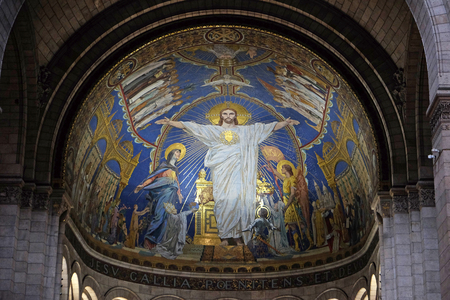 Christ in Majesty is surrounded by the Virgin Mary, Joan of Arc and St. Michael, mosaic by Luc-Olivier Merson, Basilica of the Sacred Heart of Jesus in Paris Editorial