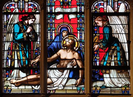 Deposition from the Cross, stained glass window from Saint Germain-l'Auxerrois church in Paris, France Stock Photo - 115510380