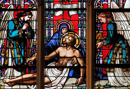 Deposition from the Cross, stained glass window from Saint Germain-l'Auxerrois church in Paris, France Stock Photo - 115510412