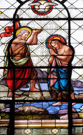 Baptism of the Christ, stained glass window in the Basilica of Notre Dame des Victoires in Paris, France