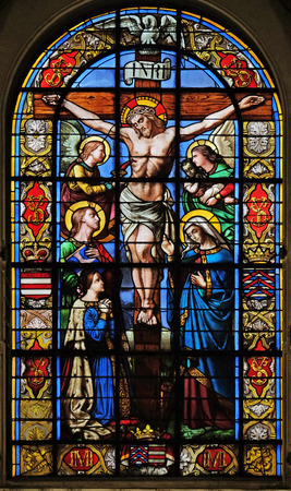 The Crucifixion by Lusson, central stained glass window in the Basilica of Notre Dame des Victoires in Paris, France