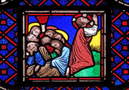 Jesus and his disciples on Mount of Olives, stained glass window from Saint Germain-lAuxerrois church in Paris, France Editorial