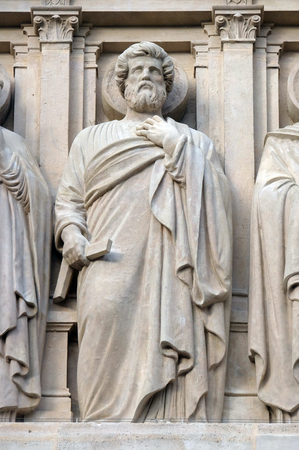Apostle, statue on the facade of Saint Augustine church in Paris, France