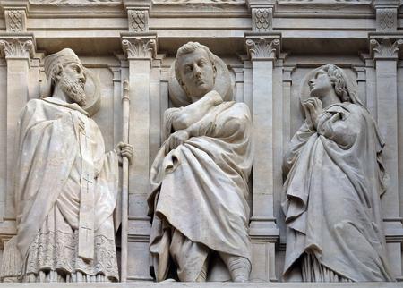 Statue of Saint on the facade of Saint Augustine church in Paris, France 版權商用圖片