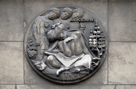 Avicenna, was a Persian polymath who is one of the most significant physicians, astronomers. He has been described as the father of early modern medicine. Stone relief at the building of the Faculte de Medicine Paris Editorial
