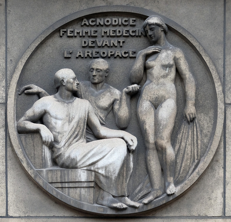 Agnodice, female doctor in front of the Areopagus. Stone relief at the building of the Faculte de Medicine Paris, France Editorial