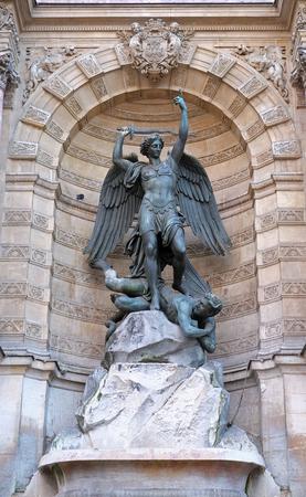 Fountain Saint Michel at Place Saint Michel in Paris. It was constructed in 1858-1860 by architect Gabriel Davioud. Archangel Michael and devil by Francisque Duret