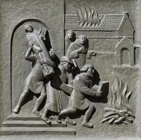 Ittingen Monastery in Frauenfeld is stormed and set on fire in July 1524., relief on the door of the Grossmunster church in Zurich, Switzerland