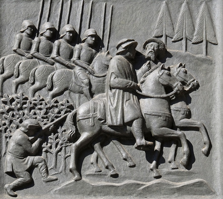Zwingli riding on the side of the mayor Diethelm Rois to the disputation in Bern, relief on the door of the Grossmunster church in Zurich, Switzerland