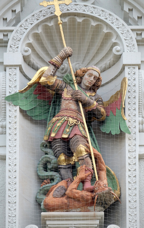 Saint Michael slaying the dragon, statue on the portal of the church of St. Leodegar in Lucerne, Switzerland Éditoriale