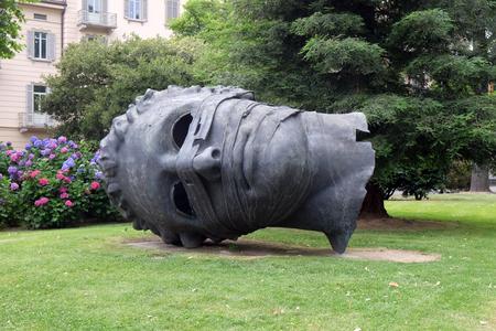 Famous monument shaped head called Eros Blindfolded, artist Igor Mitoraj in Lugano, Switzerland