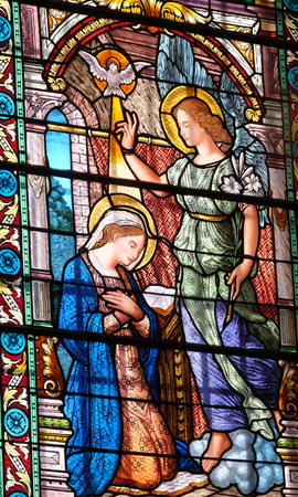 Annunciation to the Virgin Mary, stained glass window in the Cathedral of Saint Lawrence in Lugano, Switzerland Editorial