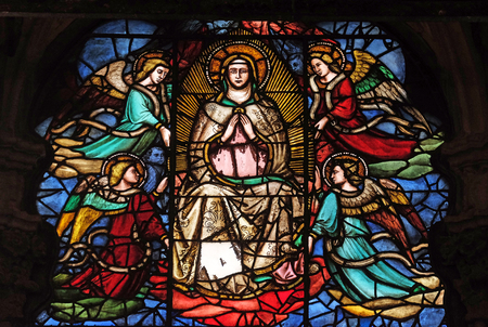 Virgin Mary surrounded by angels, stained glass window in Orsanmichele Church in Florence, Tuscany, Italy Editorial