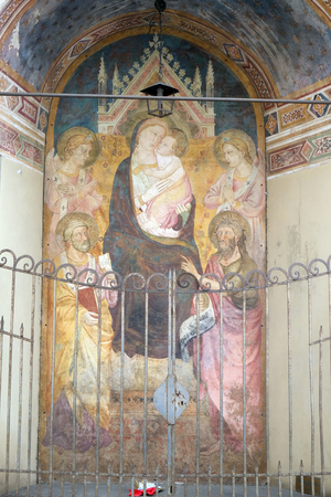 Virgin Mary with baby Jesus, fresco on the house facade in Florence, Italy Editorial