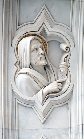 Saint, relief on the facade of Basilica of Santa Croce (Basilica of the Holy Cross) - famous Franciscan church in Florence, Italy