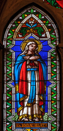 Immaculate Conception, stained glass window in the Basilica di Santa Croce (Basilica of the Holy Cross) - famous Franciscan church in Florence, Italy