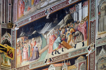 The tree grew and was made into a bridge, in front of which the Queen of Sheba kneels, then Solomon has the wood removed and sinks it, fresco by Agnolo Gaddi in Basilica di Santa Croce (Basilica of the Holy Cross) in Florence, Italy Editorial