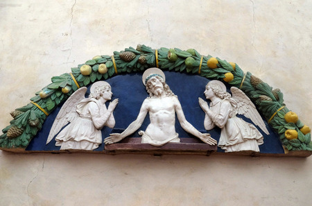 Christ in Pieta with two angels in Adoration, lunette, bas relief by Andrea della Robbia from Medici Chapel, Basilica di Santa Croce (Basilica of the Holy Cross) in Florence, Italy