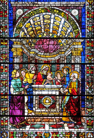 Presentation of Jesus in the Temple, stained glass window in Santa Maria Novella Principal Dominican church in Florence, Italy