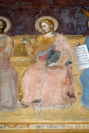 St. Luke Evangelist, detail of the Triumph of St. Thomas Aquinas, fresco by Andrea di Buonaiuto, Spanish Chapel in Santa Maria Novella Principal Dominican church in Florence, Italy