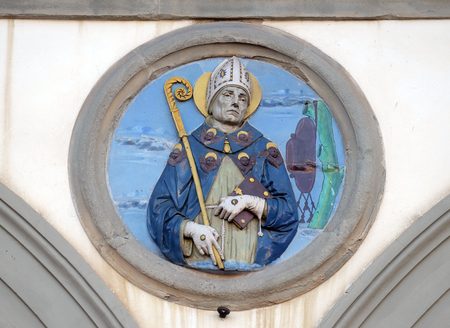 St. Bonaventure, glazed terracotta tondo by Andrea della Robbia, located between two arches of the old Ospedale di San Paolo, in Florence, Italy