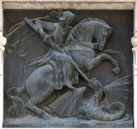 Saint George slaying the dragon relief on the building in the city of Lucca in Tuscany, Italy Banco de Imagens