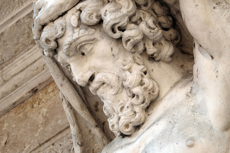 Statue of Hercules at the entrance to the 18th century Palazzo Vescovile (Bishops Palace) in the historical center of Mantua, Italy