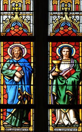 Saints Matthew and John the Evangelist, stained glass window in parish church of Saint Mark in Zagreb, Croatia