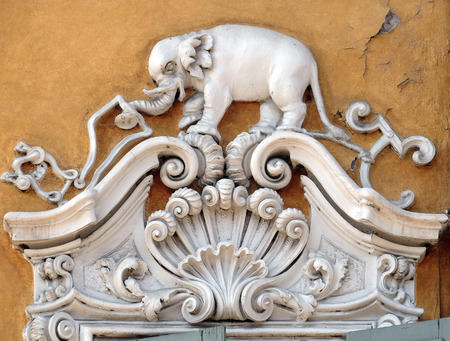 Beautiful house facade with carved stone animals in Mantua, Italy