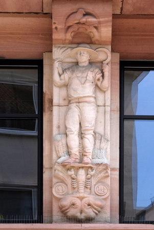 The astrological sign of Scorpio, relief on house facade in Aschaffenburg, Germany Stock Photo