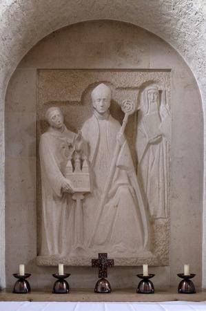 Wurzburg bishop Adalbero, the savior of the monastery Egbert and the holy Makarius of Wurzburg, altar in Munsterschwarzach Abbey, Benedictine monastery, Germany