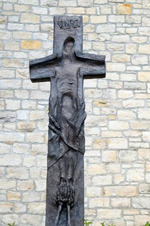 Cross by Sieger Koeder in front the Church of Saint Bartholomew in Leutershausen, Germany 写真素材