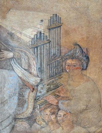 Saint Cecilia, fresco on house facade in Zagreb, Croatia Banco de Imagens