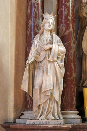 Saint Apollonia, statue on the altar of Saint Valentine in Church of Assumption of Virgin Mary in Zakanje, Croatia