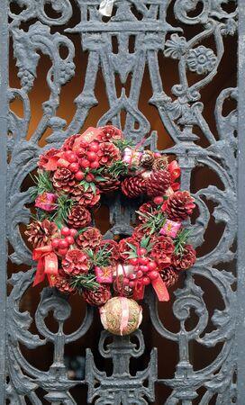 Front door to home with flower wreath, Montmartre in Paris, France