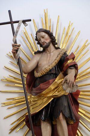 Saint John the Baptist statue in the Saint Lawrence church in Denkendorf, Germany