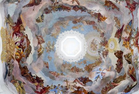 Adoration of the Holy Trinity by saints and angels ceiling fresco in Neumunster Collegiate Church in Wurzburg, Germany