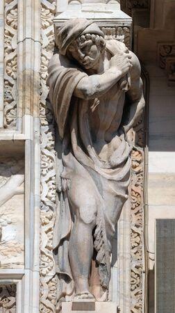 Atlantes supporting the main facade of the Milan Cathedral, Duomo di Santa Maria Nascente, Milan, Lombardy, Italy